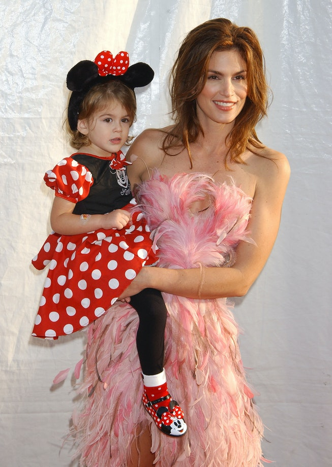 Kaia Gerber dressed as Minnie Mouse with Cindy Crawford in 2003.