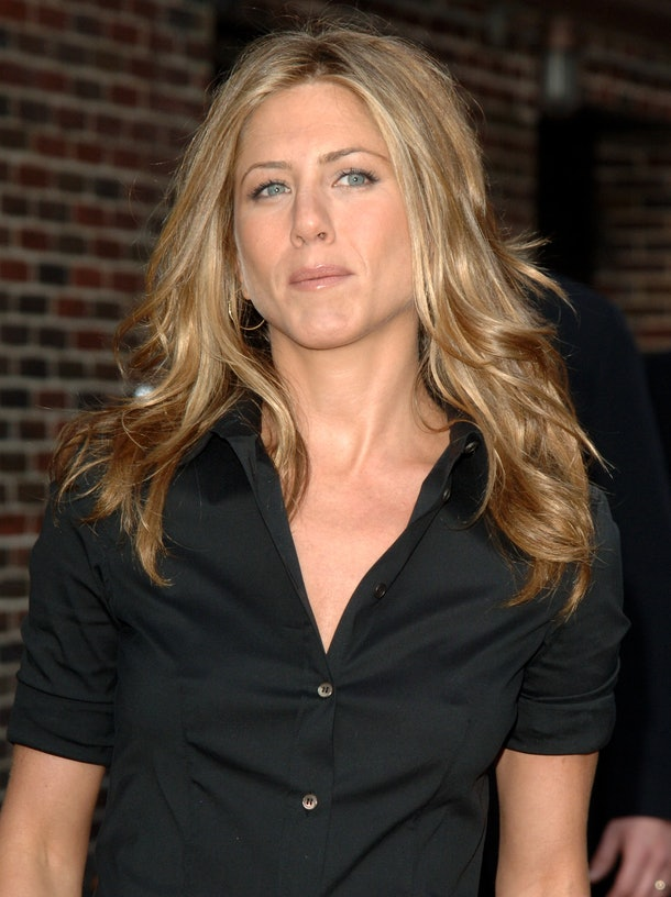 Jennifer Aniston steps out in a black button-down tee.