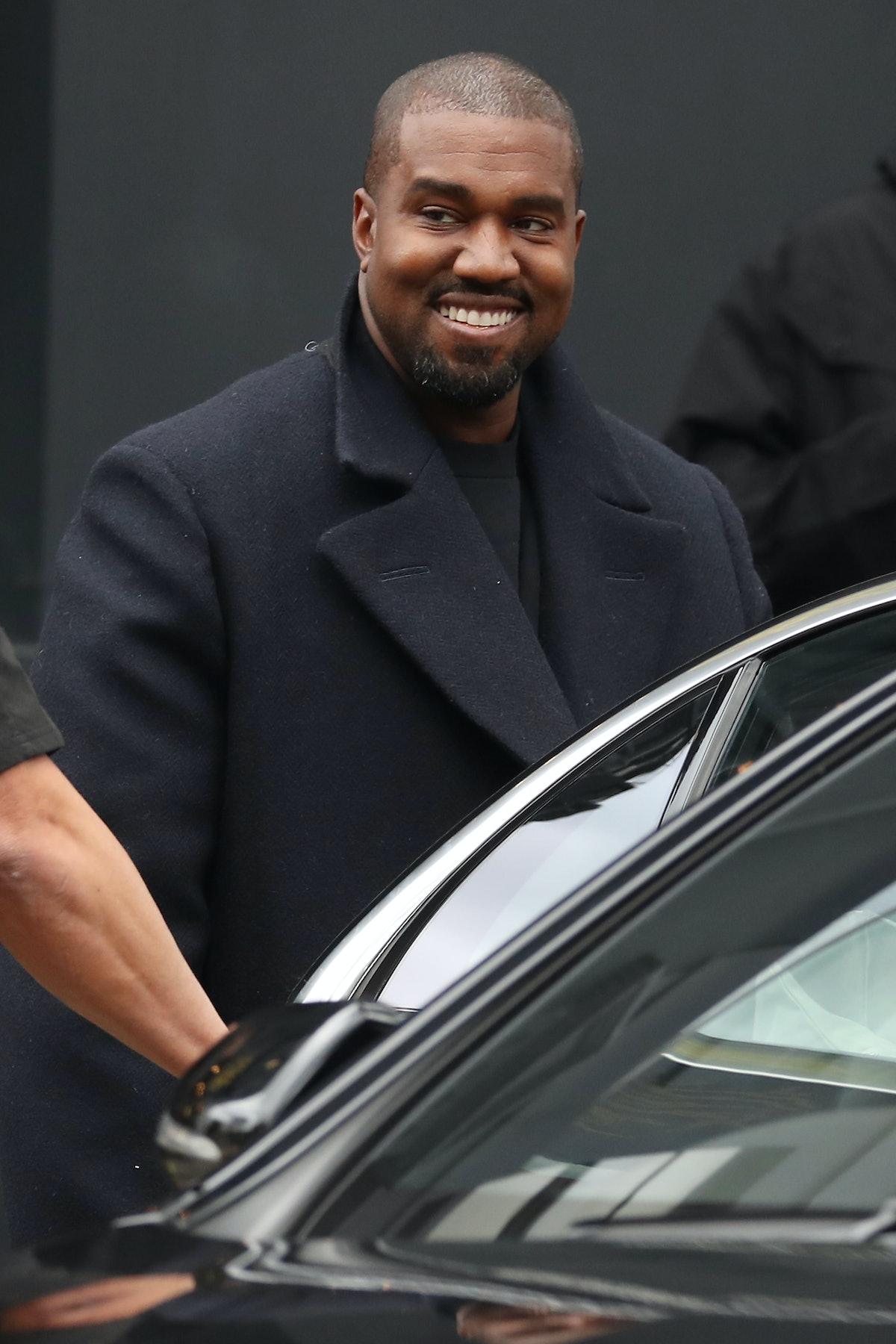 Kanye West flashes a smile.