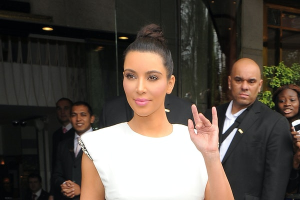 Kim Kardashian waves to fans.