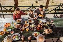 family eating thanksgiving dinner outside