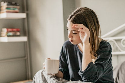 A woman drinks a mug of tea, dreading going to her ob-gyn who doesn't take her concerns seriously.