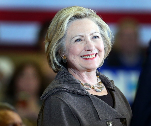 Hilary Clinton flashes a smile.