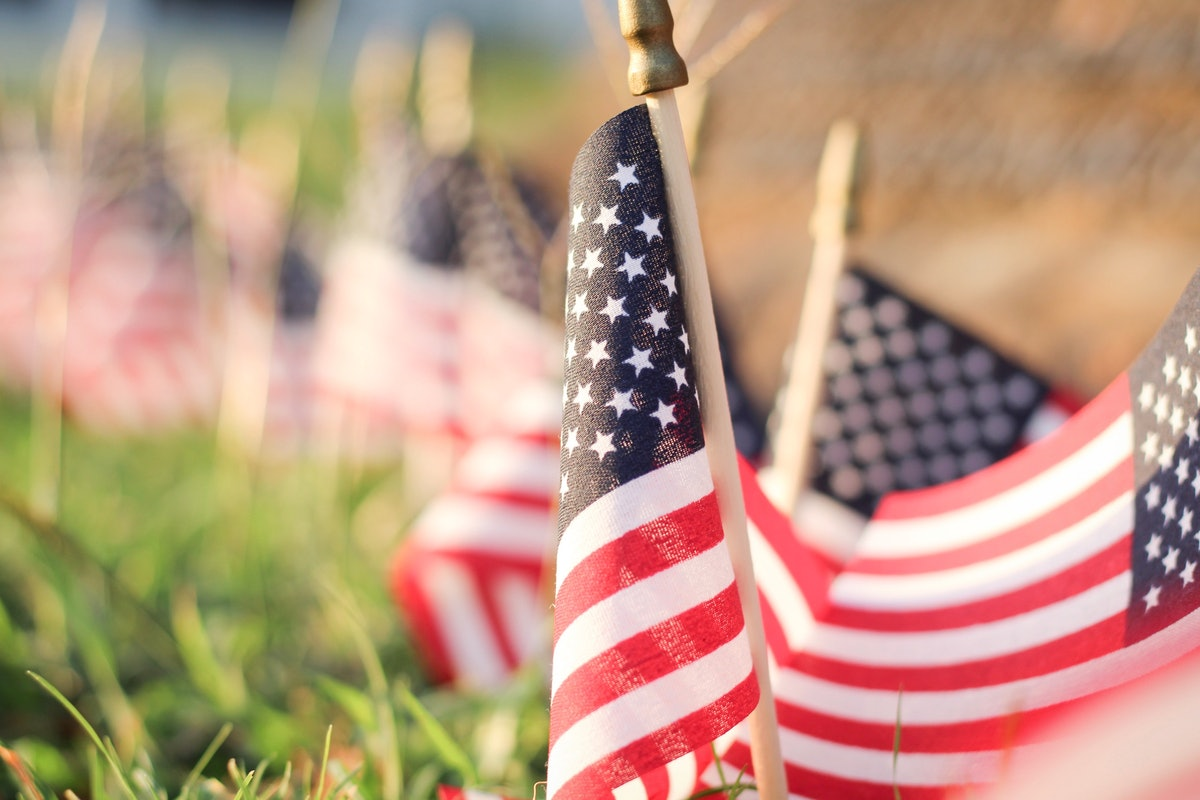 American flags in the ground. Young voters have diverse opinions on covid-19, voting, and more.