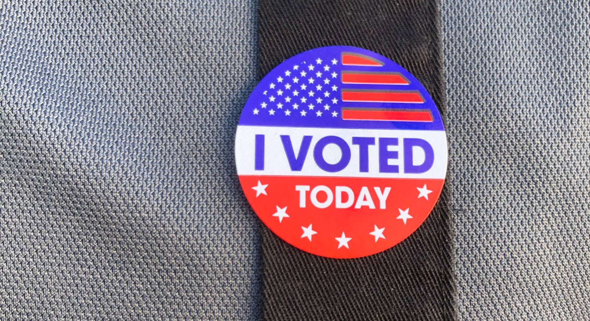 """An """"I Voted"""" button on a person's overalls. 18-34 year olds shared their voting opinions in a recent..."""