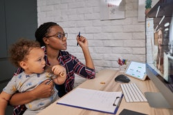 mom working from home with son on lap