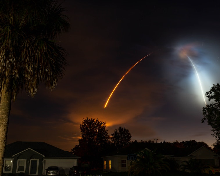 SpaceX rocket launching into space over a night sky.