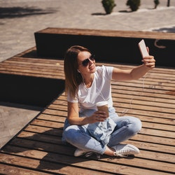 Woman looks at her most liked Instagram post.