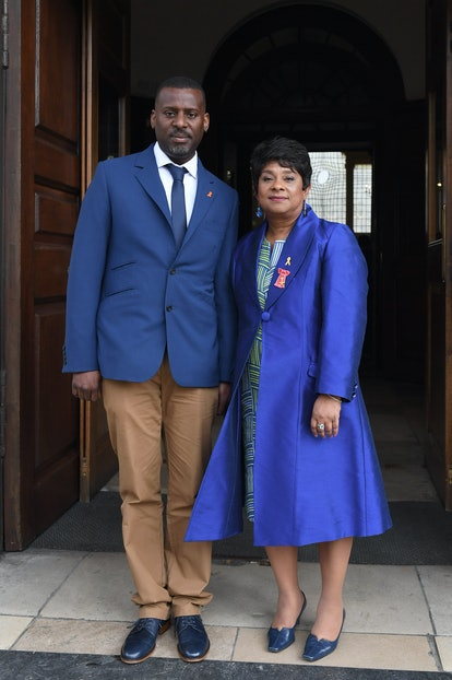 stuart and doreen lawrence wearing a blue and tan suit and blue coat respectively