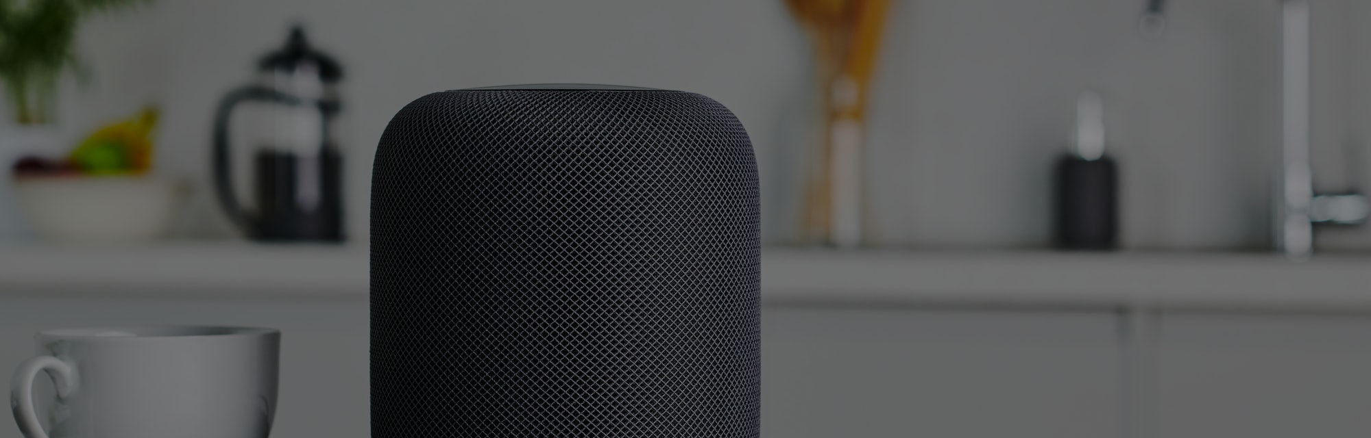 A HomePod on a kitchen table