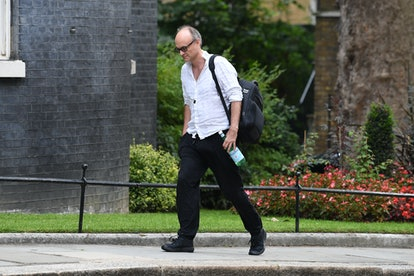 Dominic Cummings walking into Downing Street wearing a crumpled white shirt and black tracksuit bottoms
