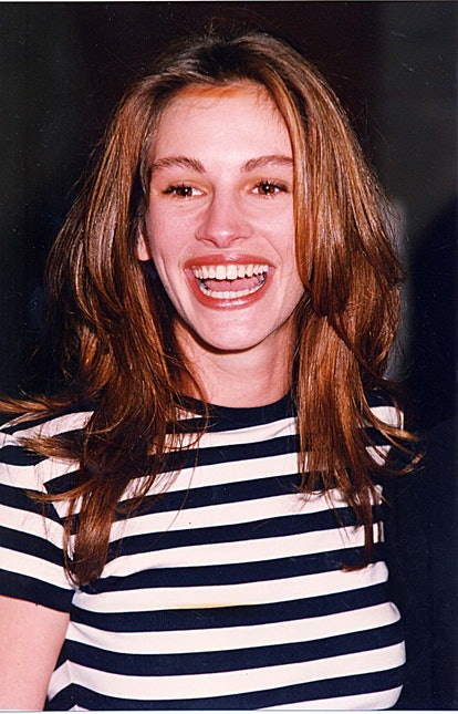 Roberts in long layered red hair.