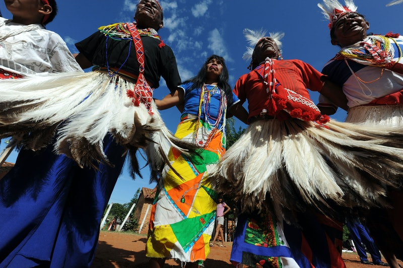 People native to what's now Paraguay dance in ceremonial garments. Here are 5 ways to celebrate Indigenous Peoples Day.