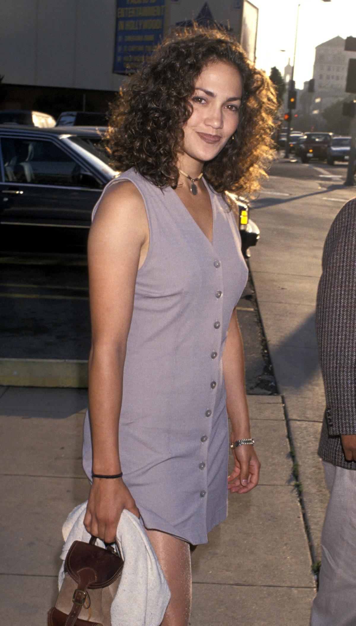 Jennifer Lopez's '90s beauty look — matte makeup, brown lipstick — is a classic.