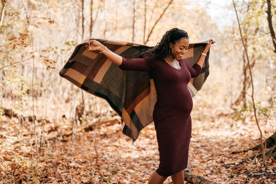 pregnant woman outside in the fall