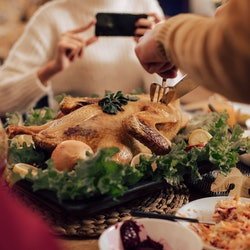 A family thanksgiving table. Experts explain how to respond to difficult political conversations at thanksgiving.