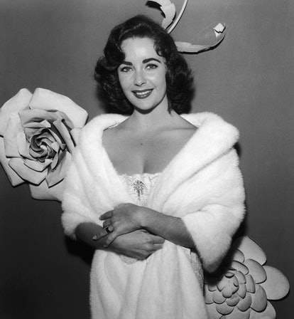 Elizabeth Taylor in a white dress and curls.
