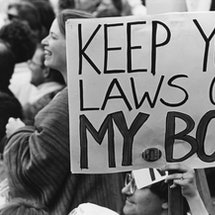 """A pro-choice protest sign reading """"keep your laws off my body."""" In this q&a, Whole Woman's Health CEO Amy Hagstrom Miller explains what a Biden presidency means for reproductive rights."""