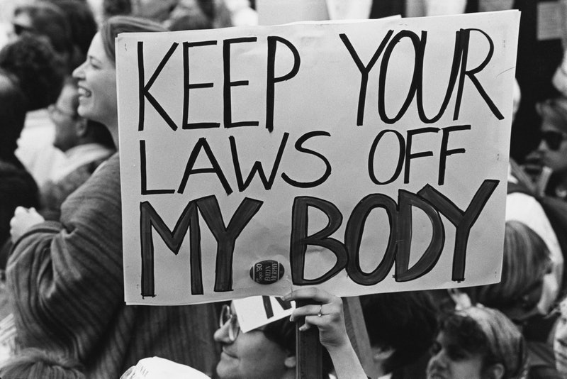 "A pro-choice protest sign reading ""keep your laws off my body."" In this q&a, Whole Woman's Health CEO Amy Hagstrom Miller explains what a Biden presidency means for reproductive rights."