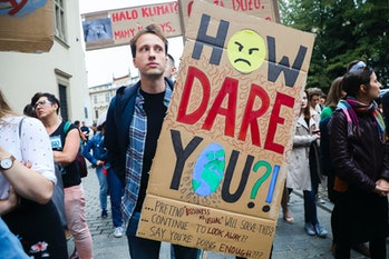 Climate protester with sign