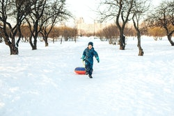 Kid running in snow.