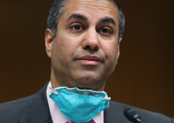 FCC Chairman Ajit Pai is pictured with an N95 mask below his chin.