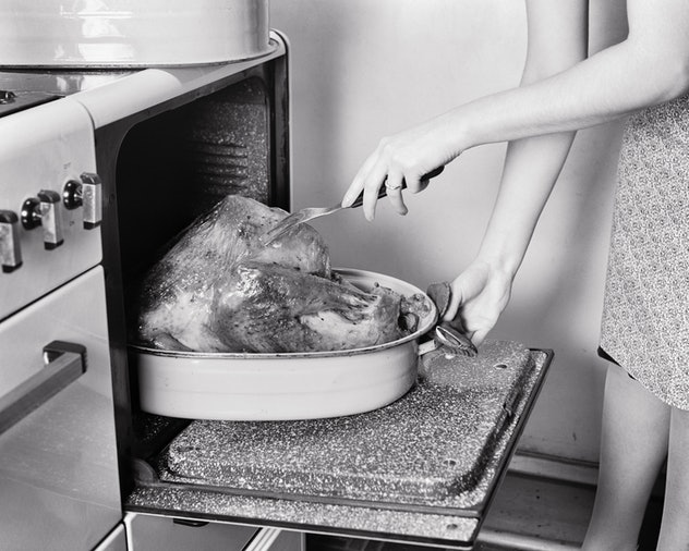 Woman checking her turkey for doneness.