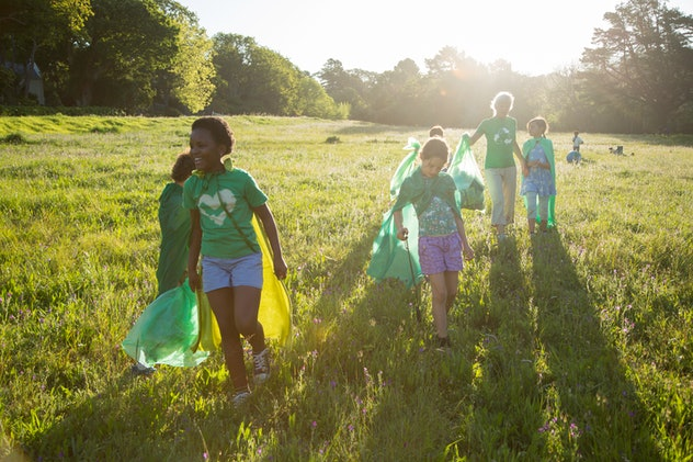 Children volunteering with their community.