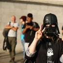 A demonstater in a Darth Vader mask star wars political protest