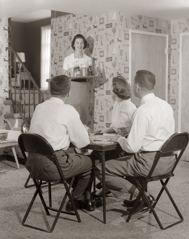 A vintage photo of two couples playing a board game. Experts believe that an isolation bubble to limit exposure and help mental health can be helpful during the pandemic.