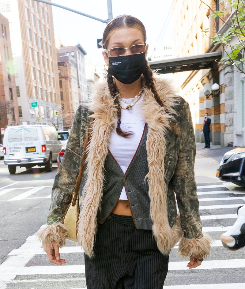 Bella Hadid rocks the color-blocking hair trend, which stylists see as a must-try for winter 2021.