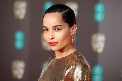 Kravitz wore lipstick that matched her earrings for one red carpet.