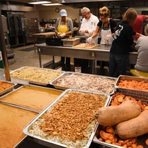 A food kitchen organizes a Thanksgiving Meal. These ideas for charities and ways to give back during Thanksgiving can help you spread holiday gratitude.