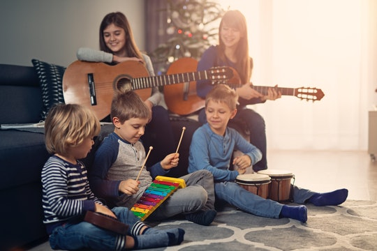 kids performing holiday song at home