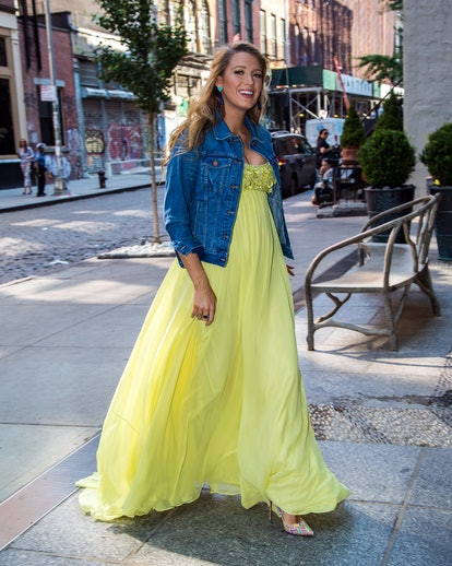 Blake Lively, pregnant, in a flowing yellow dress with a jean jacket on the streets of New York, 2016.