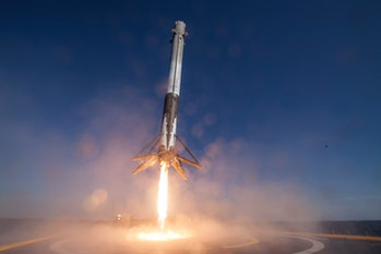 A Falcon 9 rocket coming in to land.