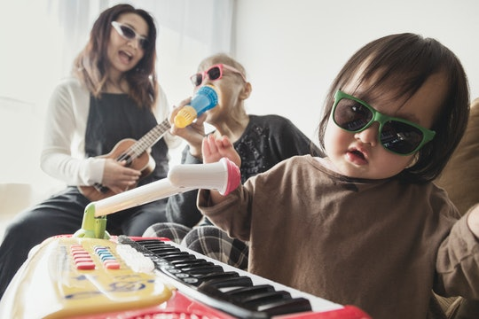 baby and family pretending to play rock music