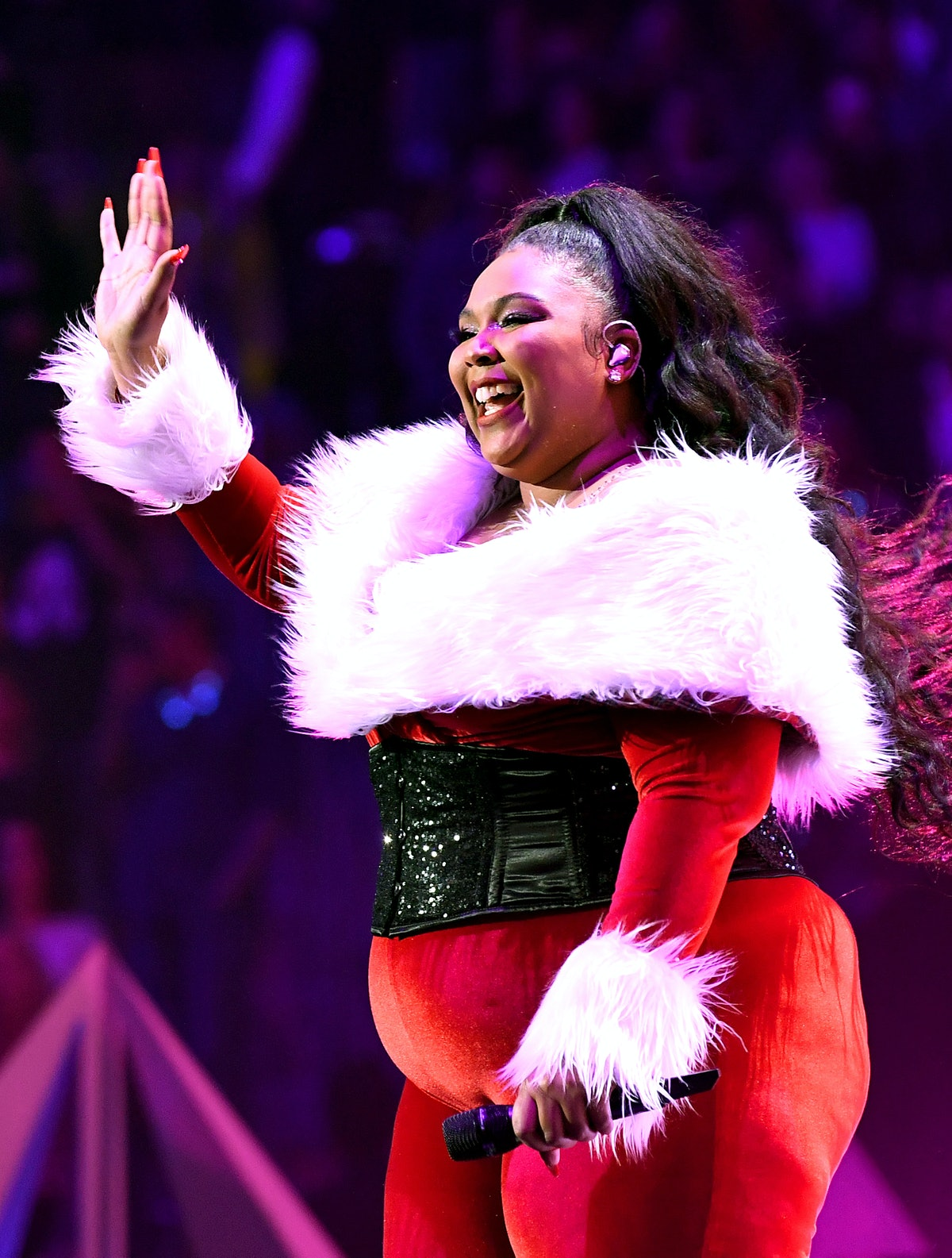 Lizzo wearing a Santa costume is a fount of inspiring self-love quotes.