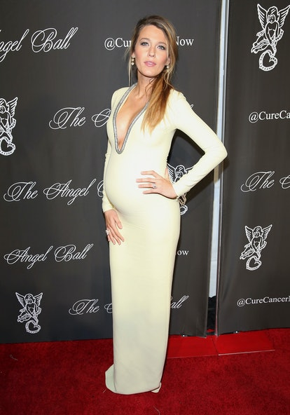 Blake Lively, pregnant, in a yellow Gucci dress, 2014.