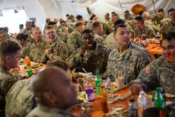 armed service members seated for thanksgiving dinner