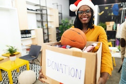 woman taking donations for holiday toy drive