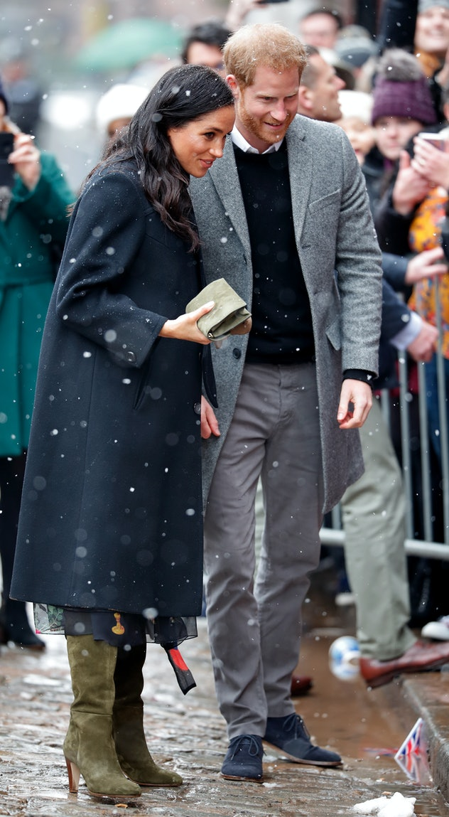 Prince Harry and Meghan Markle talk to royal fans in the snow in Bristol, Feb. 2019.