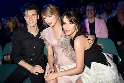 Shawn Mendes, Taylor Swift, and Camila Cabello pose for a photo.