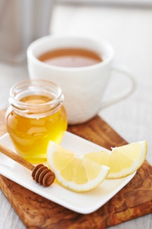 A hot toddy in a white mug has surprising health benefits.