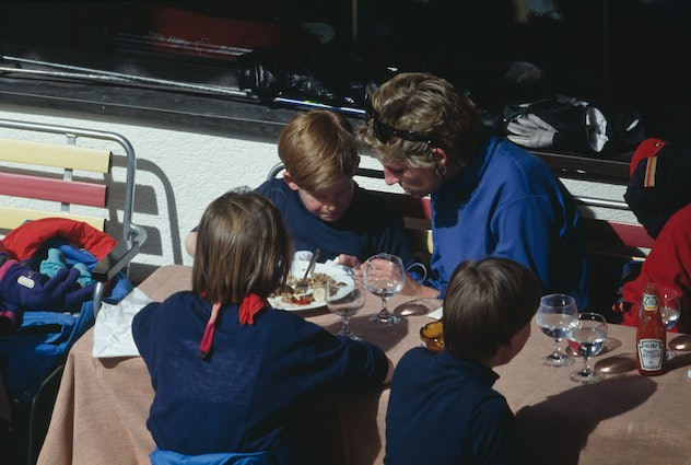 Princess Diana eats with her son Prince Harry in Austria in 1994.