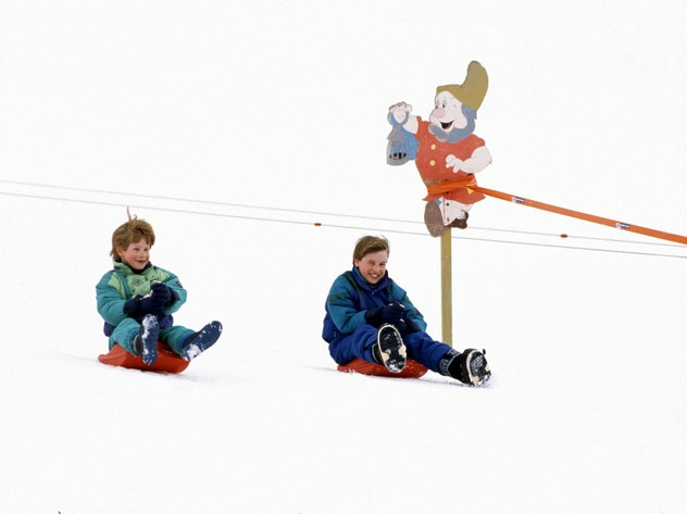 Prince William and Prince Harry enjoy sledding in Austria in 1994.