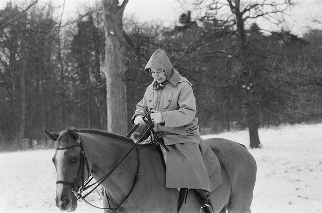 Queen Elizabeth rides her horse at Sandringham on New Year's Eve in 1979.