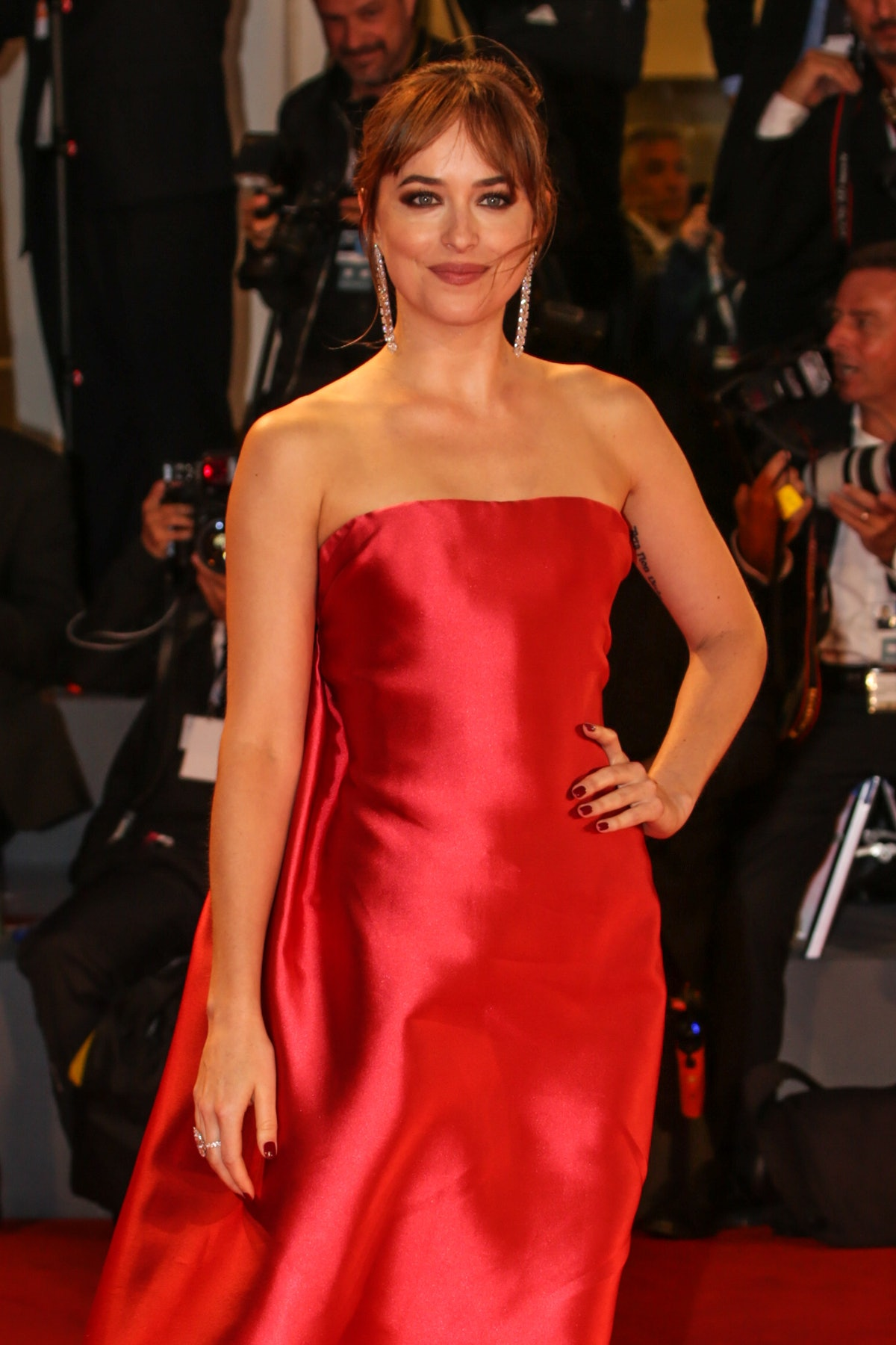 Dakota Johnson's curtain bangs are a thicker style.