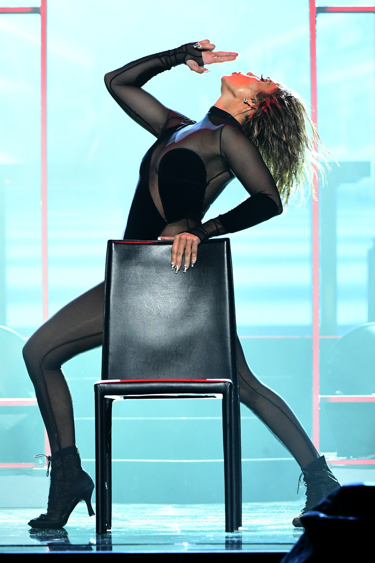 Jennifer Lopez performs at the 2020 American Music Awards.