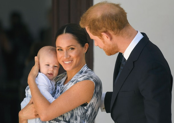 Meghan Markle poses for a photo with baby Archie and Prince Harry.
